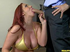 Bootylicious redhead Kelly Divine gives head to Voodoo