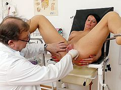 Steamy brunette mom gets her wet pussy finger fucked by rapacious doctor while she sits in the gynecological chair during doctor's appointment in steamy close up sex clip by Old Pussy Exam.