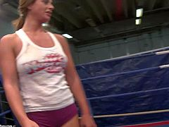 Young blonde slut Angel Long with sexy tattoo and ponytail gets naked during arousing chick with with hot ass brunette babe with big hooters in tight booty shorts in the ring