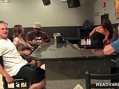 Attractive curvy babes getting paid to play sex games in a bar