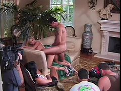 Jessica is a really hot blonde and Lezley is a buxom brunette and Evan has a big dick, so you do the math. The blonde savours his cock and the brunette stretches out in an armchair and pleasures herself while she watches the other two fuck hard.