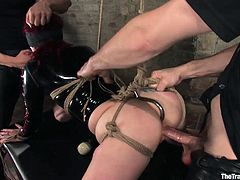 Have a look at this bondage video where an insanely busty redhead's fucked silly by these two guy's after being tied up, blindfolded and with a gag ball in her mouth.