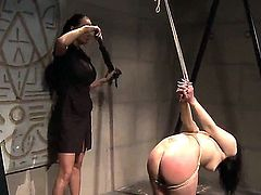 Bounded yet defiant Naomie gets her hot ass spanked by horny mistress Mandy Bright