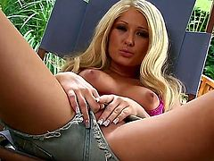 Summer Taylor is an all-American hottie, blonde, sensual and sporting jeans shorts and a cute bra. She pops her tits out and then slides her hand down her shorts, taking care of her eager clit.