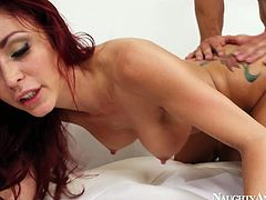 Hot tempered red-haired babe hops like crazy on a long thick dick in reverse cowgirl style before she bends down for a hard poke in doggy style.