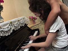 Ardent girlie is fond of playing the piano. But there's one more thing spoiled slim nympho loves the most. Girlie with smooth ass bends over the piano for getting her hairy wet cunt tickled right away.