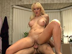 Slutty blonde milf Alana Evans is having fun with some guy indoors. She favours him with a passionate blowjob and then jumps on his prick crazily.