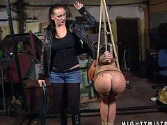 Rebellious tied up babe gets her ass spanked hard