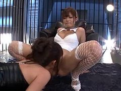 Two slim and sexy Japanese chicks in fishnets finger and lick each others wet pussies. Then they also use a double headed dildo.