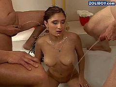 Slim brunette nympho with firm ass and great hunger for cock gets fucked hard by randy fuckers with shaved heads in gang bang and enjoys having golden shower action filmed in close up