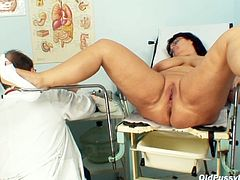 Horn made mom Daniela gets her pussy poked with dildo by gynecologist