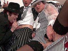 Amateur European babes in a period piece dressed up like gangsta babes take turns giving their boss man some head and toy their pussies in this threesome.