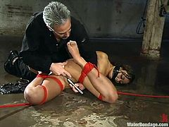 Kinky Latin bitch in latex gets tied up to a chair and gets toyed in her ass. She also gets whipped and then drowned in an aquarium.