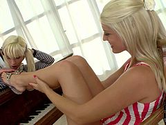 There are two sweet white haired lesbian dolls with lovely legs. They lick each others bare sexy feet and pink wet pussies with desire in lesbian foot fetish action. Watch them play!