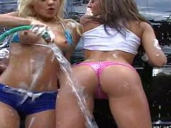 Young hot ass babes Nikki and Tiffany Brooks with natural boobs and slim sexy bodies in tight booty shorts get naughty while washing car and start making out with each other
