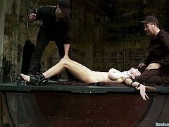 There's some fucked up stuff going on in this BDSM video where the sexy Rain DeGrey is experiencing some extreme torture naked.