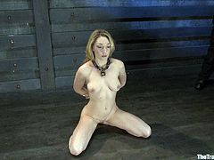 Watch this sexy servant having her tight pussy drilled by her master after she's tied up and hung in the air.