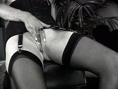 Rosemary Delain is going to give some elegant spanking to this girl in this black and white video with lingerie-clad girls.