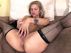 Amazing and sultry babe in fishnet stockings is masturbating her pussy with huge toy