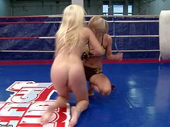 Arousing young blonde whore Nikky Thorne with big juicy tits and her partner with delicious bouncing ass get naked during rough chick fight and continue to wrestle on the floor