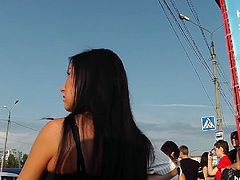 Brunette gets filmed in public and has her panties revealed by voyeur's cam