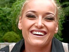 Kathia Nobili is a beautiful blond- haired european pornstar that gives interview for the camera in the back garden and then flashes her amazing tits with smile on her face.