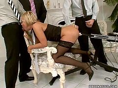Short haired smoking hot blonde Szilvia Lauren with pretty face and sexy glasses in white tie and black lingerie gets fucked hard in arousing gang bang with her horny business partners