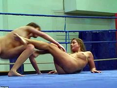 Arousing teen brunette Cathy Heaven with natural boobs and pretty face gets naked and has memorable chick fight with hot ass furious classmate in the ring filmed in close up