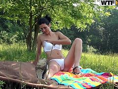 Sex greedy Russian harlow in cheap white lingerie strokes her skinny body during a picnic outdoors before an aroused dude joins her for a zealous blowjob.