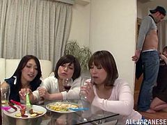 Four Japanese hotties get drunk and decide to have fun with some guy. They lick and jerk his dick off and seem to enjoy it much.