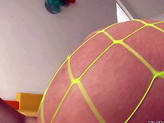 Candy Manson is one hot-bodied blonde pornstar in incredibly sexy see-through fishnet pantyhose. She shows off her lovely juicy ass and monster tits with no shame as she poses for the camera.