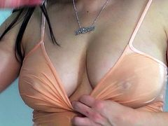 Superb brunette with big tits likes posing her wet pussy while stroking it with her fingers