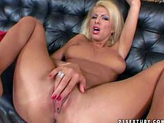 Attractive blonde Clara G. with red nail polish and smoking hot body gets naked and starts sticking fingers deep in her shaved twat to wet orgasmic feeling on leather couch
