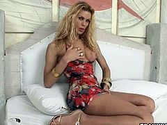 Tasty blonde shemale strips and feels herself up