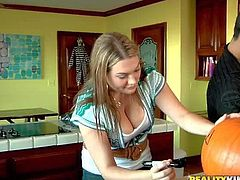 Voodoo and Cassandra Calogera get ready for Halloween together. Naturally busty clothed girl with her hands on pumpkin gets her juicy boobs grabbed by curious guy. He loves her juicy melons.