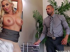 Two sex hungry colleagues make out in the office. Steamy blond milf gets her big tits and juicy ass hand stroked by rapacious dude before she kneels down to oral fuck his massive rod.