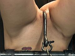 Stunning Kristine Kahill gets punished by Tomi Knox in hot BDSM video. She gets bonded and then toyed in both holes at the same time.