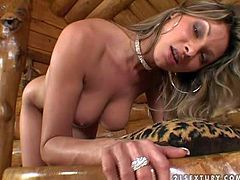 Caroline Cage is one gorgeous MILF that shows off her sexy naked body and masturbates in a hut. Round assed leggy gill shows every inch of her body and then strokes her snatch with her fingers.