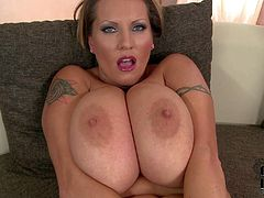 Laura Orsolya is one hot milf woman with enormously big tits. She shows off her monster jugs and then spreads her legs to play with her wet meaty pussy. Her heavy melons will make you cream your pants.