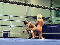Hot blonde and brunette chicks Karlie Simon and Liz are having naughty cat fight on the ring and getting hot enough to start lesbian lick and suck action.
