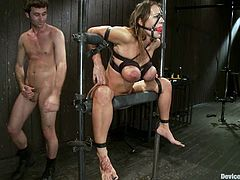 This girl will endure some extreme bondage that leave her pussy and ass exposed for James Deen and Trina Michaels to play with.