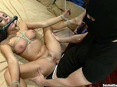Tied up blonde babe gets tied up and gagged by a guy in mask. Later on he shoves a dildo in her ass and fucks this babe rough.
