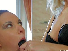 Candy Sweet gets toy fucked by lesbian domina