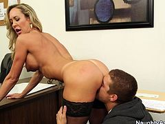 Spoiled blond college professor lures her F student by demonstrating his a juicy ass while bending over a chair. He inclines to her booty for a rapacious rimjob before taking her in doggy style with his massive cock.