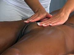 Horny ebony girl with hot body lies naked on a massage table. Later on blonde masseuse starts to fingers her tight pussy.