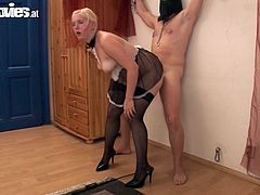 She is such a fetish bitch! Her man is chained on the wall with a head harmess on and then she sucks his hard cock. Getting spanked is her goal!