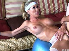 Busty milf gets nailed by her horny gym trainer and made to scream hard