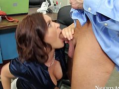 She is seduced by her co-worker right in the office. He grabs her big boobs from behind kneading them intensively. Then she kneels down to give deepthroat blowjob.