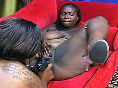 Watch two horny and kinky ebony bbw munching and dildoing their shaved slits into kingdom come in this hot lesbian video.