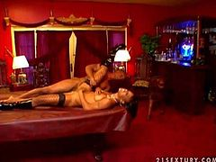 Young looking slutty ebony with natural boobs and heavy make up in fishnet stockings and long leather boots screams loud with her randy muscled black bull is pounding her hard